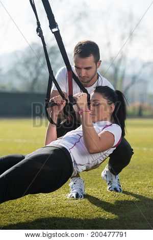 Sports Couple Training With Trx Fitness Straps