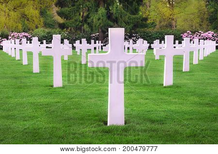 White marble headstones from an American memorial graveyard displayed in a perfect symmetry located in Hamm Luxembourg city.