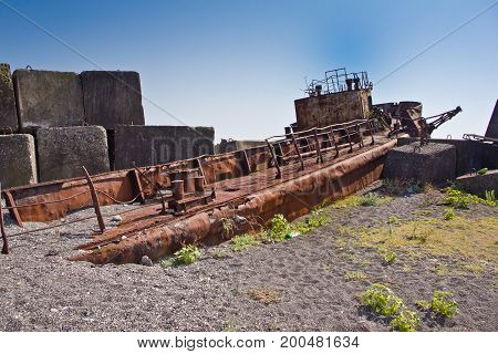 Rusty abandoned shipwreck on the beach in Sukhum, Abkhazia, Georgia