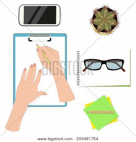 Office desktop top view, hands writing on paper