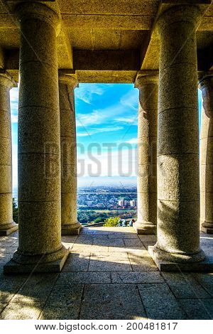 The Cape Peninsula seen from between the colonnades of Cecil Rhodes monument on the slopes of Table Mountain at Cape Town South Africa