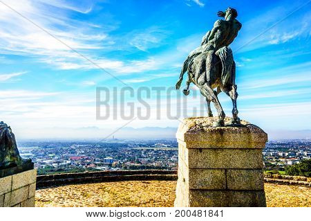 Bronze statue of Cecil Rhodes overlooking Cape Peninsula from the slopes of Table Mountain at Cape Town South Africa