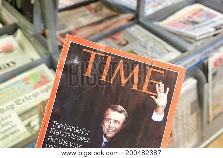 LONDON ENGLAND - MAY 14 2017 : Emmanuel Macron on cover page of Time magazine. Time is an American weekly news magazine published in New York City.