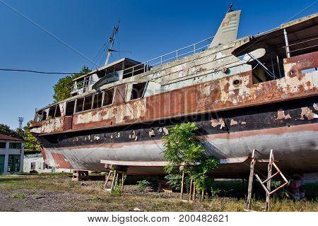 Rusty abandoned ship on the beach in Sukhum, Abkhazia, Georgia
