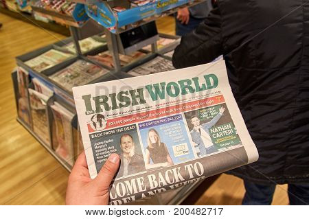 LONDON ENGLAND - MAY 14 2017 : The Irish World newspaper an a newspapers background. The Irish World is a weekly newspaper for Irish people in Britain and their families.