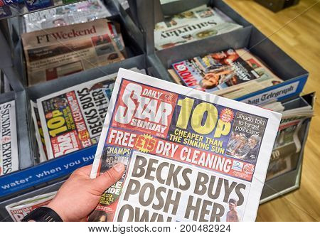 LONDON ENGLAND - MAY 14 2017 : A hand holding Daily Star Sunday newspaper. The Daily Star Sunday is a weekly tabloid newspaper published in the United Kingdom.