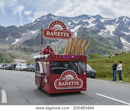 Col du Lautaret France - July 19 2014: The vehicle of Banette during the passing of the advertising caravan on mountain pass Lautaret during the stage 14 of Le Tour de France 2014. Before the appearance of the cyclists there is a caravan of advertising ca