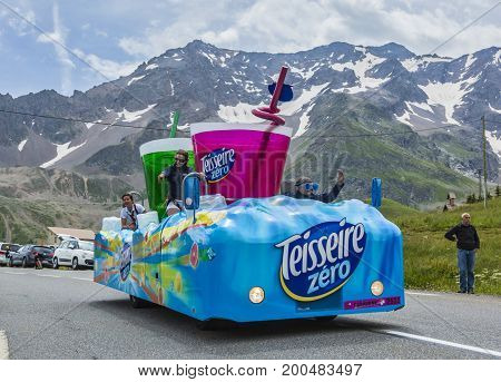 Col du Lautaret France - July 19 2014: The vehicle of Teisseire during the passing of the advertising caravan on mountain pass Lautaret during the stage 14 of Le Tour de France 2014. Before the appearance of the cyclists there is a caravan of advertising