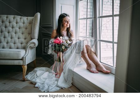 Woman By The Window. Bride Looking Out The Window, She Waits For The Groom.