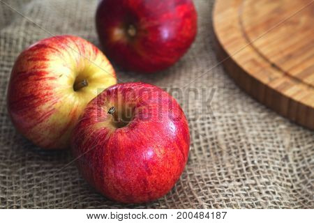 Apples on burlap with shallow depth of field.