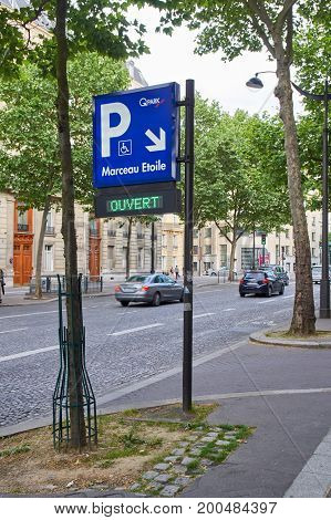 PARIS FRANCE - MAY 10 2017 : Q-Park sign on avenue Marceau in Paris. Q-Park is an operator of parking garages in Belgium Denmark Germany Finland France and other countries.