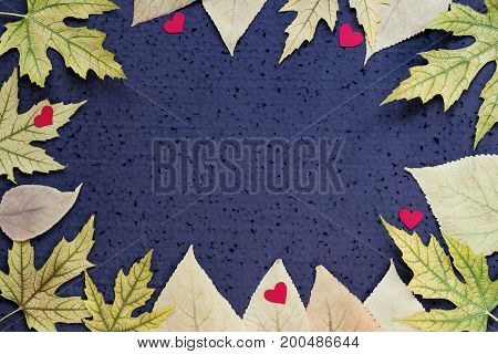 Autumn Decor - Frame Of Yellow Leaves And Red Hearts On A Black Background. Copy Space