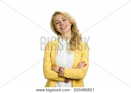 Happy young woman crossed arms. Successful business woman smiling isolated on white studio with crossed arms.