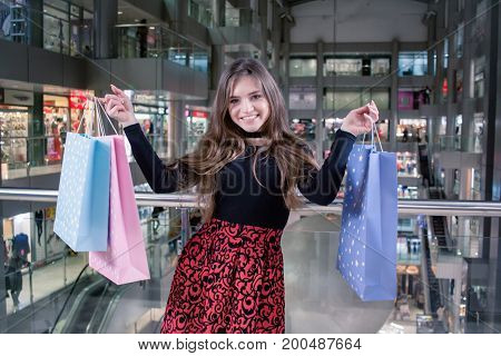 young lady shopper in mall, smiling woman at shopping