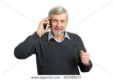 Concentrated senior man with phone. Mature man in office wear talking on smartphone and thinking. Elderly pensive man with mobile phone on white background.