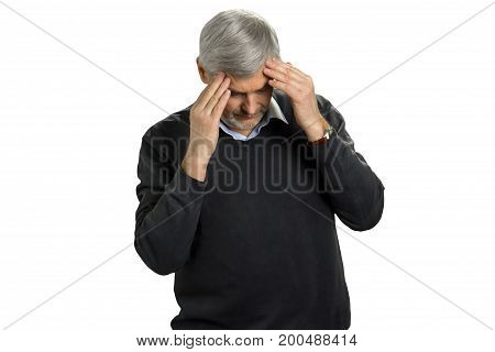 Portrait of mature man touching his head. Frustrated mature man touching his head with fingers and keeping eyes closed.