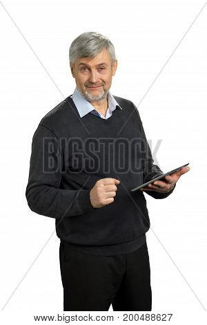 Mature man holding computer tablet. Senior severe entrepreneur clasped his fist while holding digital tablet.