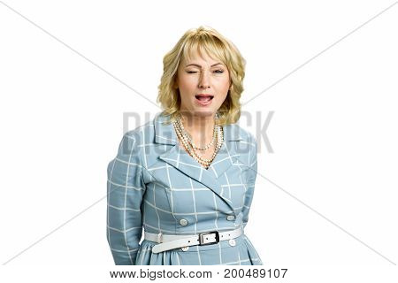 Portrait of twinkling mature woman. Playful mature woman in twinkle isolated on white background.