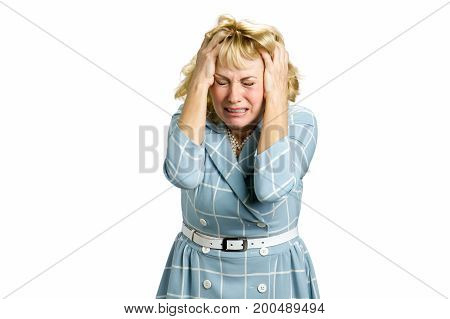 Portrait of crying despair woman. Portrait of stressed and frustrated white-skin woman in deep depression screaming with desperate and horrified expression, white background.