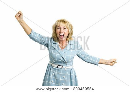 Excited mature woman clenching fists. Happy white-skin woman clasping her fists in excitrement in different sides on white background. Human expressions of victory.