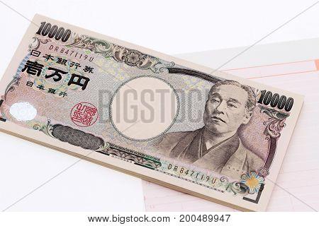 Japanese money and bankbook isolated on white background