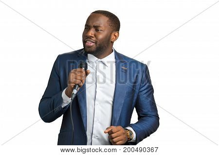 Professional jazz singer, white background. Afro american man in elegant suit with microphone. Black singing artist.