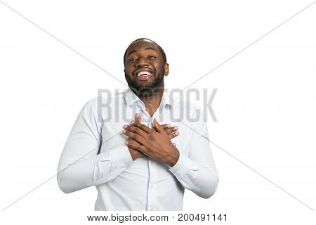 Businessman with crossed hands on chest. Facial expression and gesturing. Excited manager on white backgound. Really happy black man.