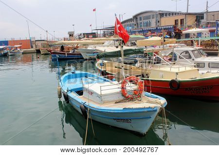 Parking for boats moored in the city harbor (Antalya, Turkey) in July, 2017.