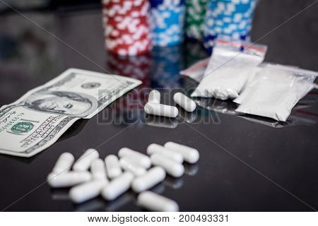 money, cocaine, pills drugs and pocker chips
