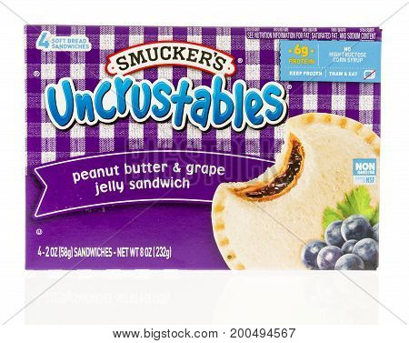 Winneconne WI - 14 August 2017: A box of SMuckers uncrustables peanut butter and grape jelly sandwich on an isolated background