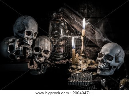Skull and scary scene for Halloween with candle light