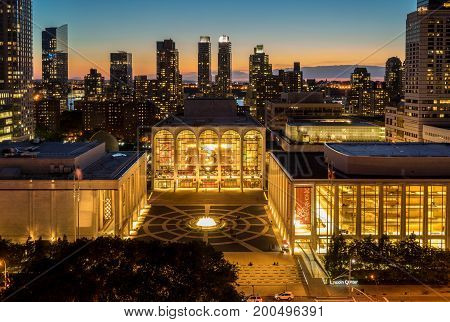 New York NY USA - June 1 2017. Sunset view of Lincoln Center Opera House and New York City skyline.