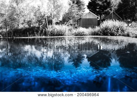 Counrtyside lake with dramatic reflections background hd