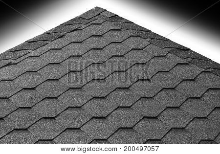 Roof pyramid tiles with gradient sky background