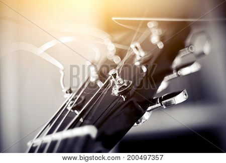 Detail of a musical instrument. Strings on a guitar.