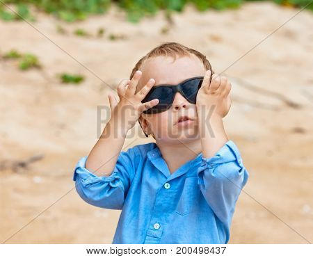 Portrait of cute 2,5 years old child with sunglasses