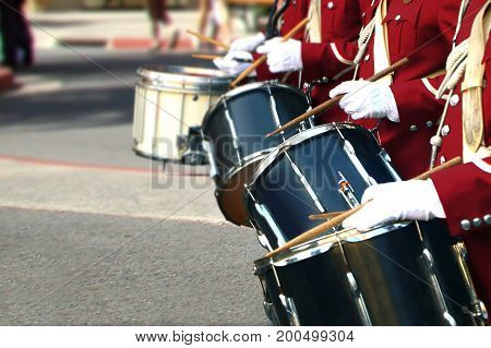 Brass band drum player in close up
