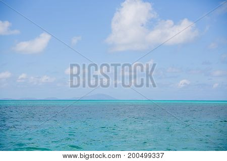 blue sky blue teal water horizon sea landscape