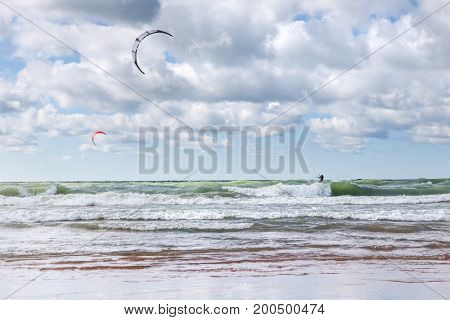 Kite surfers in the waves