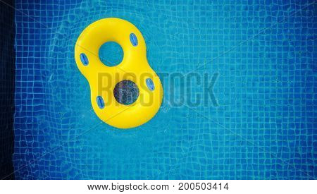 Top view, yellow swim pool float, floating on swimming pool