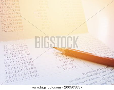 Business, finance, savings or mortgage background concept ; Pen and savings account passbook on white background