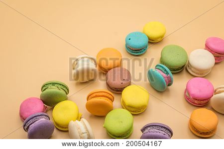 Colorful Macaron sweet and delicious on cream color background.