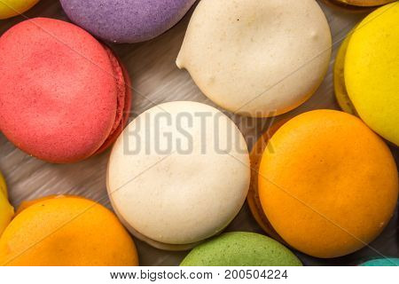 Colorful Macaron sweet and delicious on white wooden.
