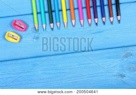Colorful Crayons And Sharpener On Boards, Copy Space For Text