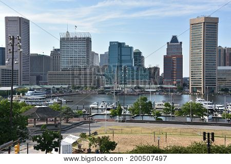 BALTIMORE, MARYLAND - JUL 2: View of Inner Harbor, from Federal Hill Park, in Baltimore, Maryland, as seen on July 2, 2017. The Harbor is a historic seaport, tourist attraction and landmark.