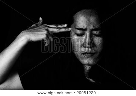 Depressed Female With Finger Pointing On Head. Suicide Concept.
