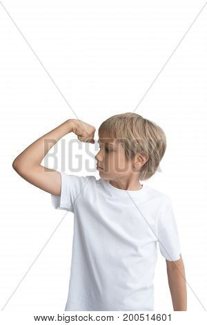 Caucasian boy showing his hand biceps muscles strength, isolated on white background.