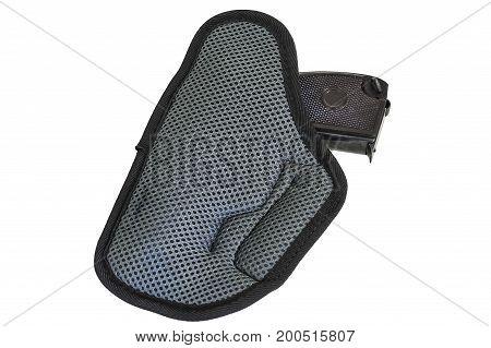 Handgun in the nylon holster. Isolated white background