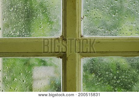 drop of water on glass window frame in rainy day