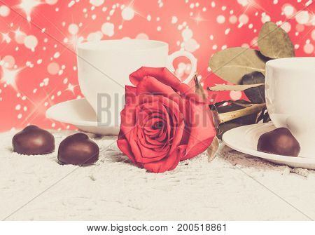 Beautiful Red Rose And Cup Of Hot Tea With Chocolate